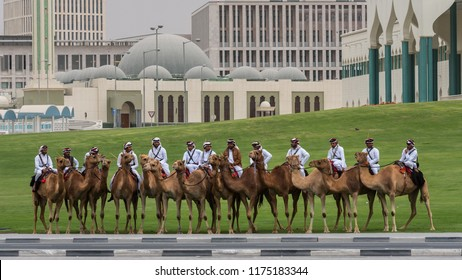 DOHA, QATAR - SEPTEMBER 9,2018: Police on camel in traditional clothes in Doha, Qatar. Doha has a unique police squad wearing traditional Arabic costume.
