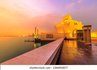 Doha seafront and West Bay skyline along Corniche in Qatari capital with Dhow Harbour lighting at blue hour. Doha in Qatar. Middle East, Arabian Peninsula, Persian Gulf. Twilight shot.