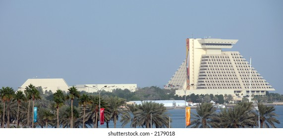 The Doha Sheraton hotel and Resort and the Conference Centre in Qatar. Taken November 2006. The Doha Asian Games which are advertised in the flags and the sign on the side of the hotel.