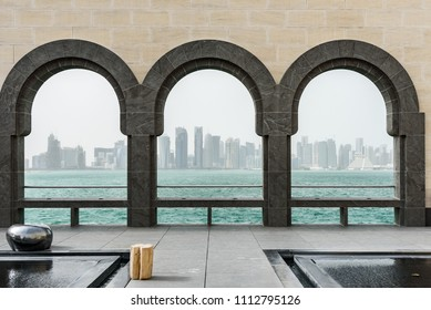 Doha skyline and arches at Museum of Islamic art, Qatar