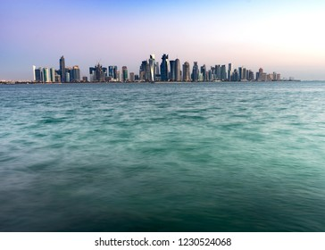 Doha skyline with silky smooth ocean in the foreground