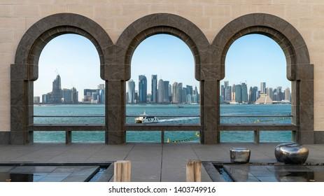 Doha skyline through the arches of the Museum of Islamic art, Qatar