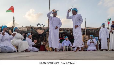 Doha,Qatar-December 11,2019: Oman traditional folklore dance (Ardah dance)  in Katara cultural village