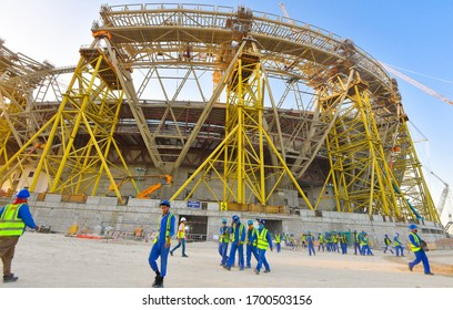 DOHA,QATAR-Feb 15, 2020 : Workers walk towards the construction site of the Lusail Stadium under construction which is scheduled to host the opening and final matches of the Qatar 2022 FIFA World Cup
