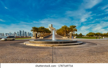 Doha,Qatar-July 28,2020: Doha cor niche  daylight view with museum of Islamic art and Doha skyline in background and fountain in foreground