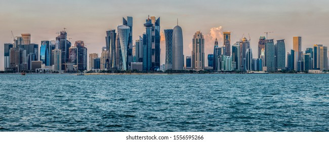 Doha,Qatar-November 11,2019: Doha skyline in Cor niche daylight panoramic view with clouds in the sky