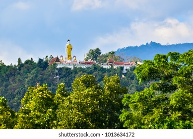 Doi Kham temple on the mountain of chiang mai province, this the beautiful temple on the hill with mountain in the background for ling of tourist.
