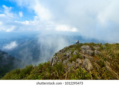 Doi Luang Chiang Dao, Chiang Mai Province in Thailand - 16 December, 2017: Sweet couple traveler sightseeing the beautiful scenery of nature and mist during time the sunset at Doi Luang Chiang Dao