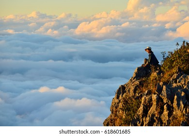 DOI LUANG CHIANG DAO, THAILAND - JANUARY 6, 2017. The tourist sitting on the rock for viewing the sunset at Doi Luang Chiang Dao in Chiang Mai, Thailand.