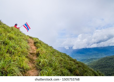 Doi Luang Tak, Tak Province, Thailand. AUGUST 31,2019:Hikers are sitting and waving flags to the rain forest at Doi Luang Tak,Tak Province,Thailand.