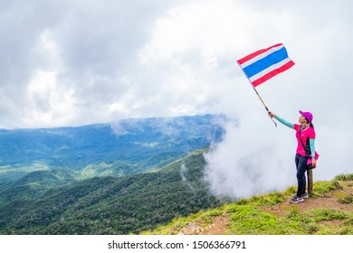 Doi Luang Tak, Tak Province, Thailand. AUGUST 31,2019: Hikers are standing and waving flags to the rain forest cover by fog at Doi Luang Tak,Tak Province,Thailand.