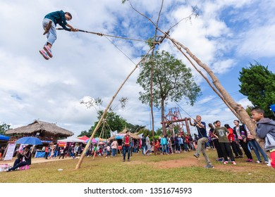 Doi Mae Salong, Chiang Rai - THAILAND, September 8, 2018 : Akha tribe playing with the wooden swing on Akha Swing Festival. The annual Akha Swing Festival is pretty much about women and fertility.