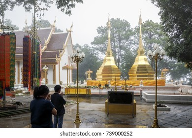 Doi Tung twin golden Buddha's relics in raining and foggy day at Chiang Rai province norther of Thailand
