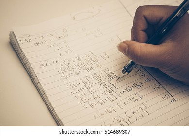 Doing math homework / Solving Exponential Equations