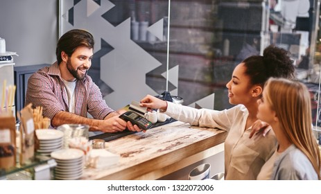 Doing nothing for others is the undoing of ourselves. Small business, payment, people and service concept - woman with credit card buying coffee at cafe or coffee shop