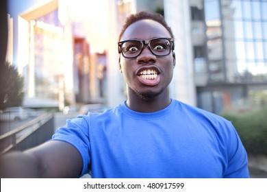 Doing a selfie with a weird expression