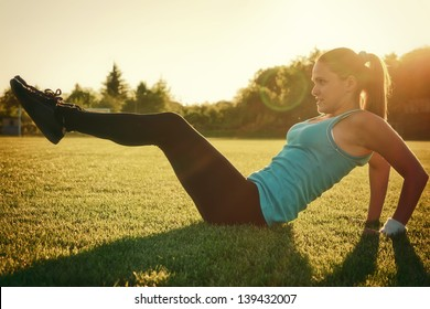 Doing sport in sunset / Young woman do sport on a play-ground