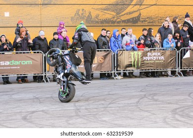 Doing the tricks on a motorcycle. St. Petersburg Russia - 15 April, 2017. International Motor Show IMIS-2017 in Expoforurum. Sports motorcycle show of bikers on the open area.