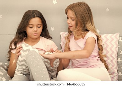 Doing whatever they want. Girls sleepover party ideas. Soulmates girls having fun sleepover party. Girls happy friends with cute pillows. Pillow fight pajama party. Sleepover time for pillow fight.