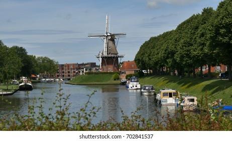 DOKKUM, HOLLAND - CIRCA JULY 2017:  a windmill in the beautiful village of Dokkum, Frisia, Holland.