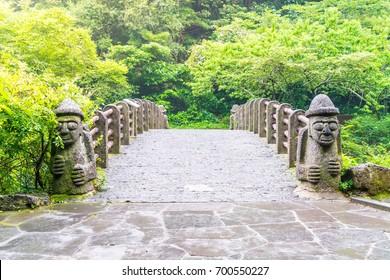 Dol hareuban bridge at Cheonjiyeon Falls in Jeju Island, South Korea
