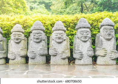 Dol hareubang in garden park at Cheonjiyeon Falls, Jeju ,South Korea
