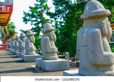 Dol hareubang rock statue at YakchunsaTemple in Jeju Island, South Korea.