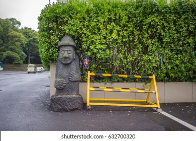 "Dol hareubang at the side of a road in Jeju City.The name dol hareubang derives from the Korean word for ""stone"" , plus the Jeju dialect word hareubang, meaning ""grandfather"" or ""senior""."