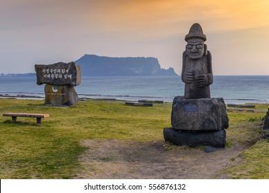 Dol hareubang statue and Jeju do Seongsan Ilchulbong, Jeju Island, South Korea