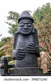Dol hareubangs, statues on Jeju Island of South Korea on rainny. They are considered to be gods offering both protection and fertility
