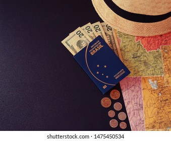 Dolar coins, brazilian passport, dolar notes, hat and map. Travel concept. Money savings.