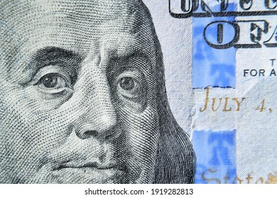 Dolar USA close up. Franklin eyes macro. The texture of the fragment of the dollar bill. USD banknote texture. One hundred American dollars. $ 100. - Shutterstock ID 1919282813