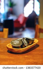 Dolce gusto capsules on a wood table and wood bowl
