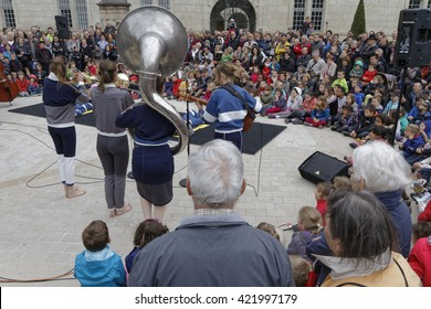 "DOLE, FRANCE, May 14, 2016 : Free street festival ""Cirque et Fanfares"" (Circus and brass bands) stands in the old streets of Dole, in Jura region."