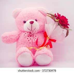 Doll bear pink with red rose. Valentine day. style vintage pink