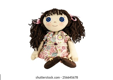 Doll with brown hair isolated on white