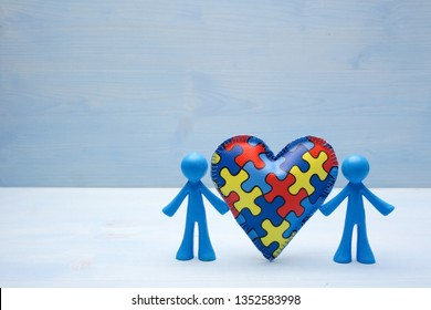 doll children background with symbolic autism puzzle heart