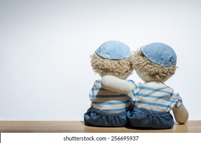 A doll consoling another one