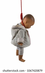 Doll figure hanging the neck, baby kill concept, child abortion, child abuse