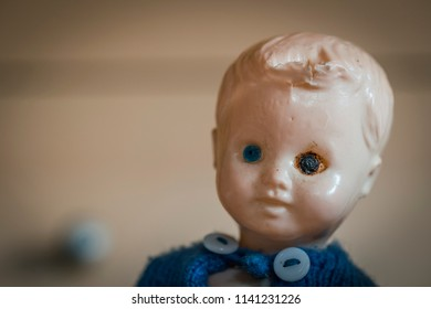Doll head with scars illustrating domestic violence and child abuse victim