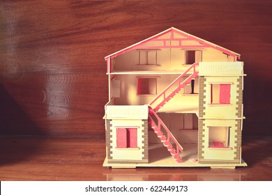 doll house on wooden background