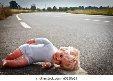 doll leave on highway lane