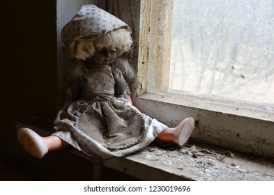 Doll on windowsill in abandoned kindergarten in destroyed village of Kopachi (10-km Chernobyl NPP alienation zone), Ukraine