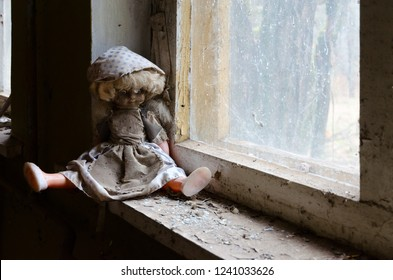 Doll on windowsill in abandoned kindergarten in destroyed village of Kopachi, Chernobyl NPP Exclusion Zone, Ukraine