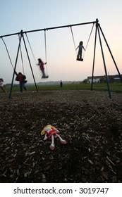Doll in swing park