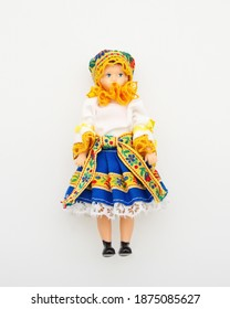 Doll in a traditional east European folklore dress isolated on white