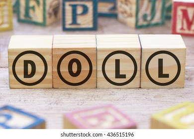 Doll word written on wood cube