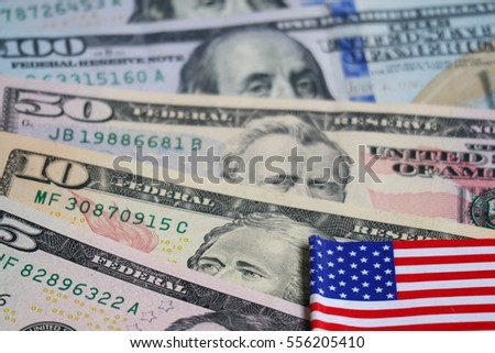 Dollar banknote and coin with USA flag