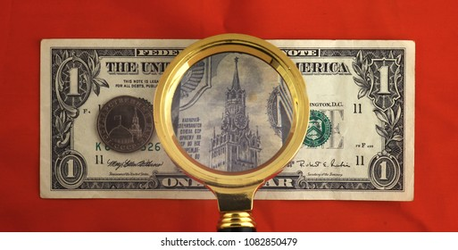 Dollar banknote magnified by a magnifying glass - instead of Washington one can see the Moscow Kremlin
