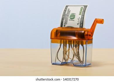 Dollar banknote in a paper shredder